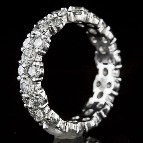 PPD158-101P Mid Century-inspired large and small diamond common prong 3-row platinum wedding eternity band