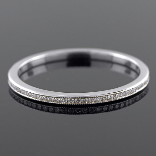 055-101P Ultra thin channel set round white diamond platinum wedding eternity band