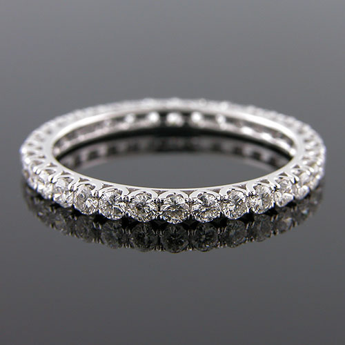 5843-101P Modern common prong-set diamond arched wedding eternity band
