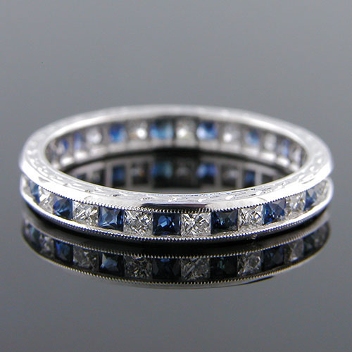 563-442 Antique inspired reproduction French cut sapphire and French cut diamond platinum wedding eternity band