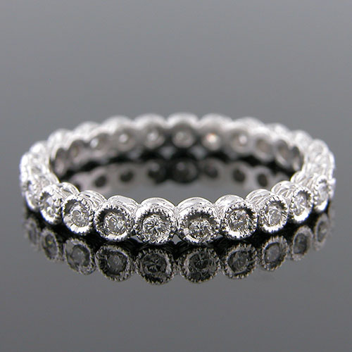 729-101 Antique style bezel set diamond platinum engraved eternity wedding band