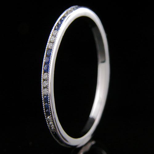 055-446P Ultra thin channel set alternating round sapphire and white diamond platinum wedding eternity band
