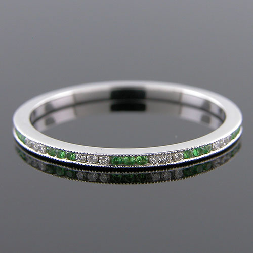 055-246P Ultra thin channel set alternating round tsavorite and white diamond platinum wedding eternity band