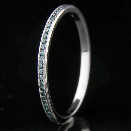 055-180P Ultra thin channel set round treated blue diamond platinum wedding eternity band